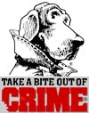 Photo that says take a bite out of crime with a dogs face looking at you.